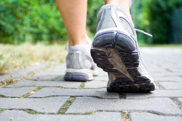 Close up of walking or cross-training sneakers on a cobblestone path