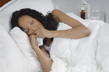Woman with flu lying in bed