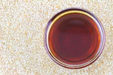 Sesame oil on white seeds