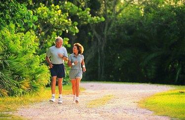 Hispanic senior couple jogging