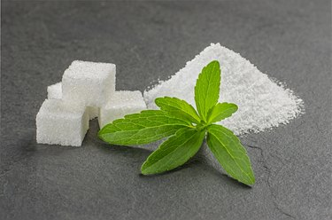 Stevia leaves with stevia powder and sugar cubes