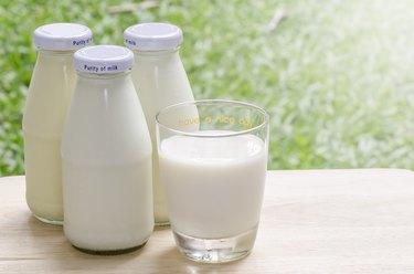 Bottles of fresh milk on table