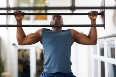 african man doing pull-ups on a bar