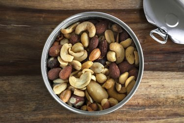 Can of healthy nuts over a cutting table