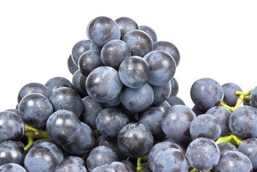 Bunches of Purple Grapes Isolated on White