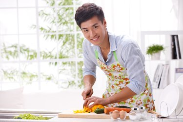 Young man cooking in kitchen