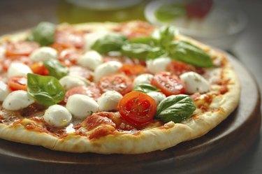 Freshly baked tomato and mozzarella pizza