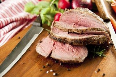 Medium Rare Beef Roast Served with Various Vegetables