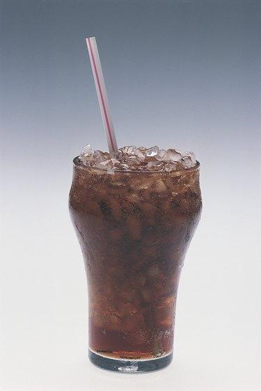 Glass of soda with straw