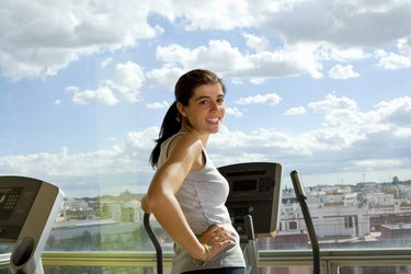 Woman on a cardiovascular machine in front of a window