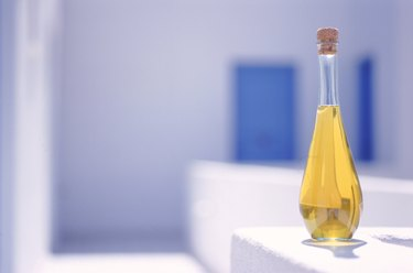 Cooking oil in bottle with cork, close-up