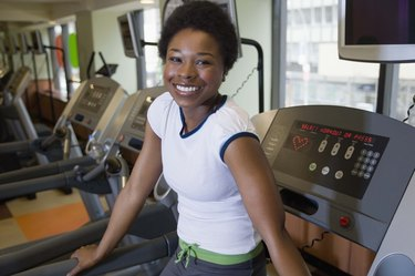Woman on treadmill in gym