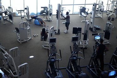 People working out in gym, elevated view