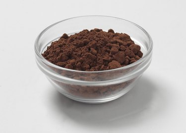 Cocoa powder in a glass bowl, studio shot