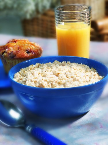 Photo, bowl of oatmeal, muffin and a glass of orange juice, Color, High res