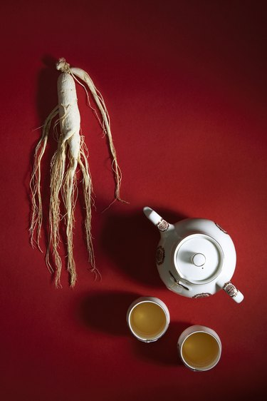 Ginseng root and tea pot with cups