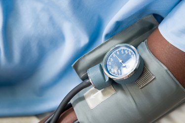 Blood pressure cuff on arm of patient