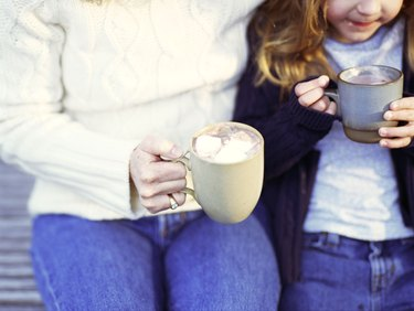Mother and daughter with hot chocolate