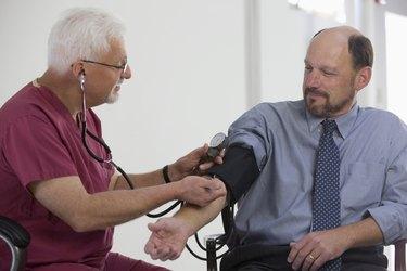 Doctor measuring patient's blood pressure