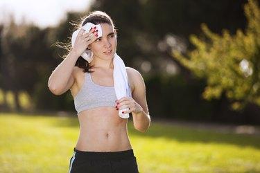 Woman refreshing atfer running