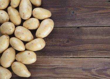 Frame of potatoes on old wood II