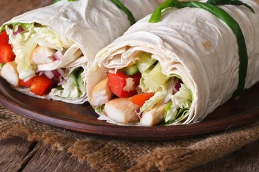 Lavash roll with chicken and vegetables closeup horizontal