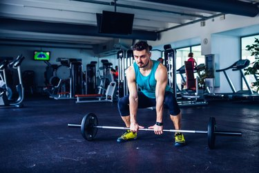 Crossfit instructor at the gym doing Deadlift exercises