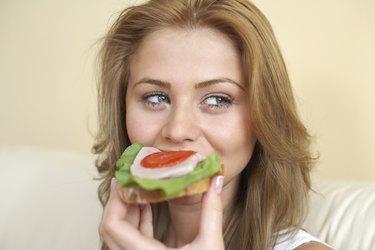 Woman eating healthy sandwich