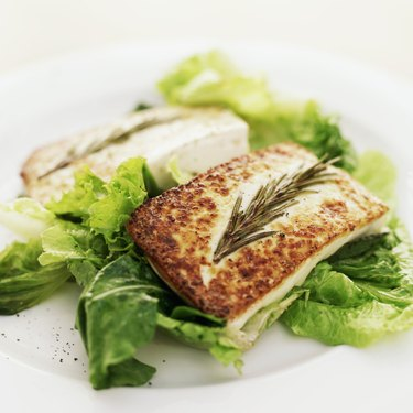 close-up of grilled cheese served on lettuce greens