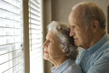Couple waiting by window