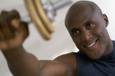 Man lifting weight, close-up