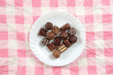 Plate of chocolates on pink tablecloth