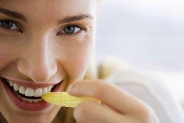 Woman eating corn