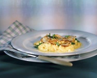 Scrambled eggs with edible mushroom in plate