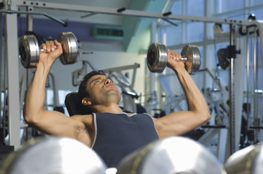 Man Weightlifting on Bench With Dumbbells