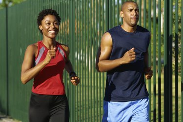 Close-up of two young people jogging