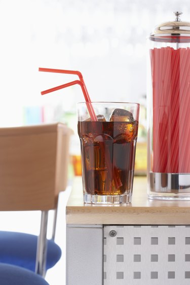 Drink and straw in glass