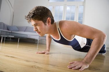 Young man performing press-ups