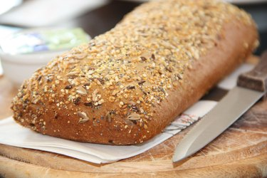 Fresh whole grain bread cut in half