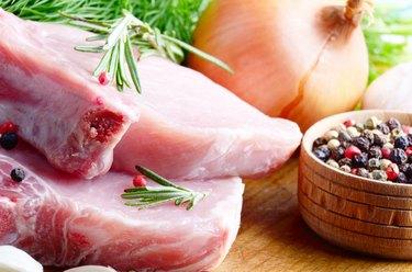 Pork loin on cut board