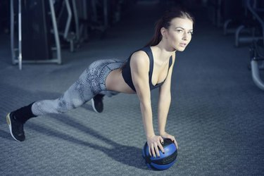 Work out fitness woman doing exercises with medecine ball