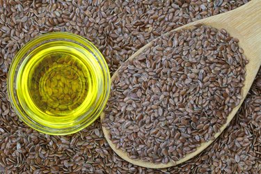 Cold pressed Linseed yellow oil on flax seeds