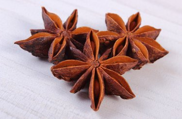 Star anise spice on white wooden table
