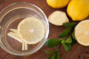 Lemon Ginger Tea with wooden Background