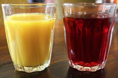 Image of glasses of orange juice and cranberry juice