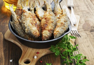 Fried fish in a frying pan