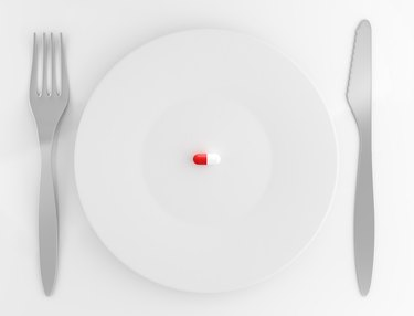 Capsule pill on plate