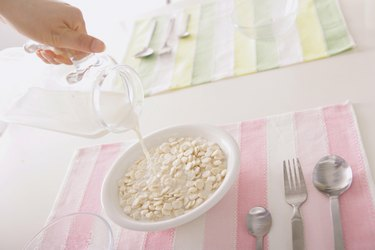 Pouring Milk To Cereal
