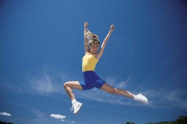 Cheerleader leaping in air