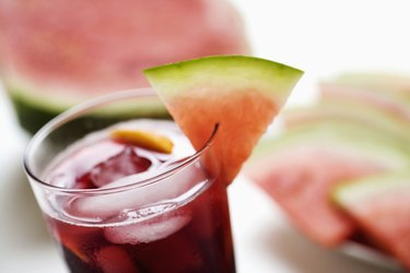Glass of juice with watermelon slices, close-up